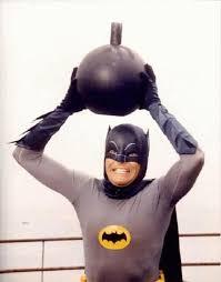 Adam West's Batman holding a bomb