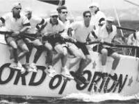 The Sword of Orion yacht with some men sitting on it (black and white image)