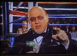 The cut man on the screen in front of the boxing ring
