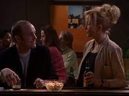 The stranger and Dana talking at the bar