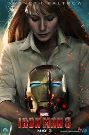 Pepper holding a badly damaged Iron Man helmet
