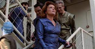 Janeway looking at the factory in Part 1