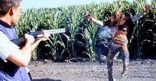 A man shoots a Klingon with a shotgun