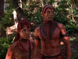 A native alien man, the chief, and one of the young women of the tribe