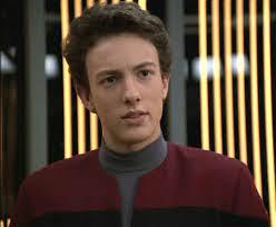 Q Junior in a Starfleet uniform