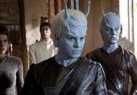 Two Andorians and two Vulcans behind them